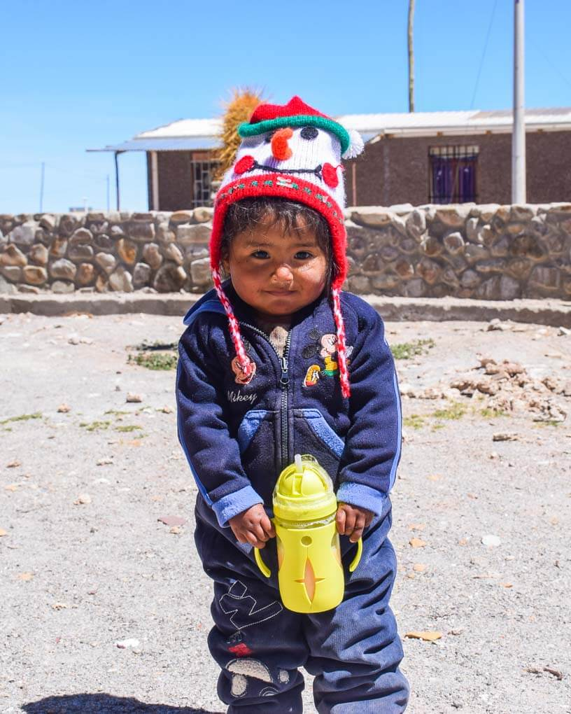A young kid rugged up on the salt flats in Bolivia