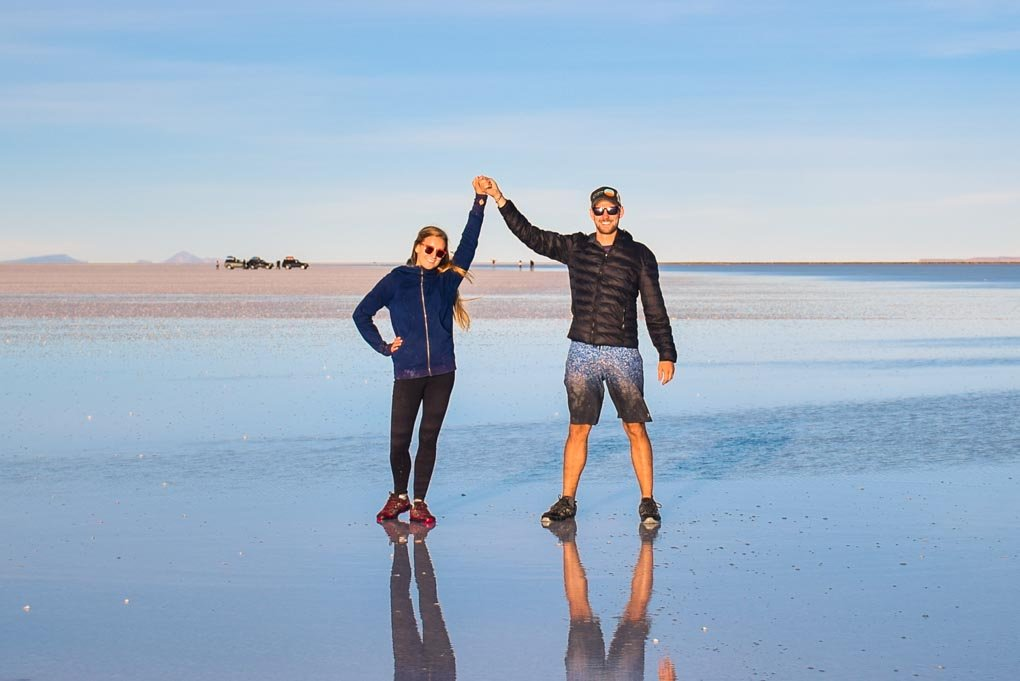 Bailey and Daniel pose for a photo on the salt flats in Bolivia
