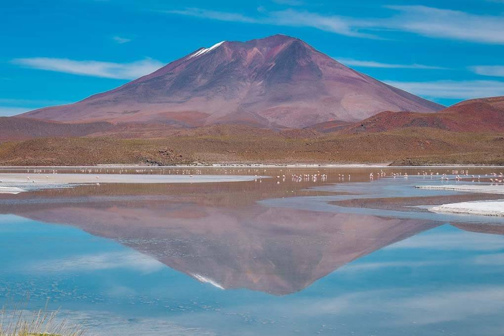 A reflection of a mountain on a lake on the salt flats tour from Uyuni