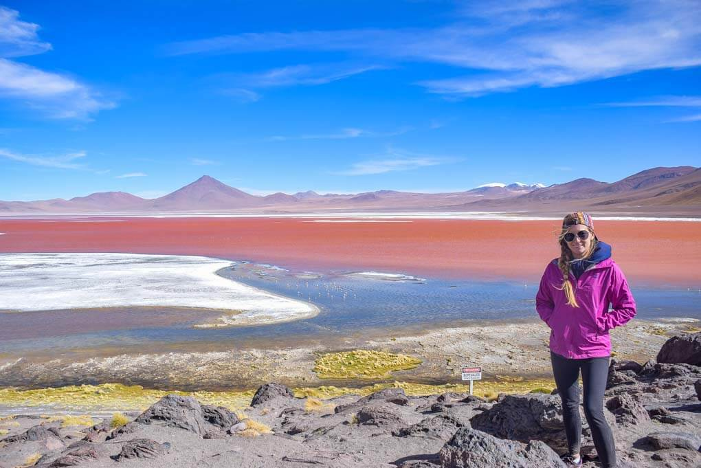Bailey poses for a photo at a lake on our Salar de uyuni tour in Bolivia