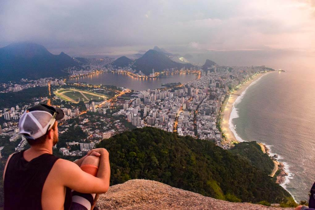 Daniel sits at the top of the Two Brother hike aka Morro Dois Irmãos overlooking Rio de Janeiro, Brazil
