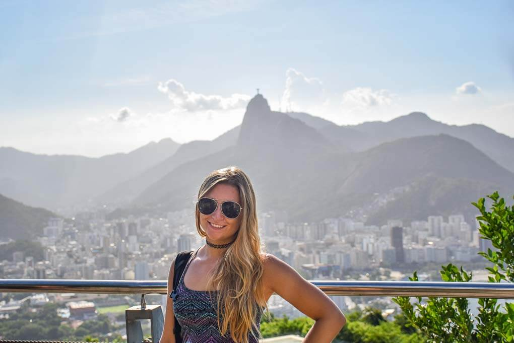Bailey posses for a photo on a viewpoint overlooking the ciaty of Rio de Janeiro in BrazilBailey posses for a