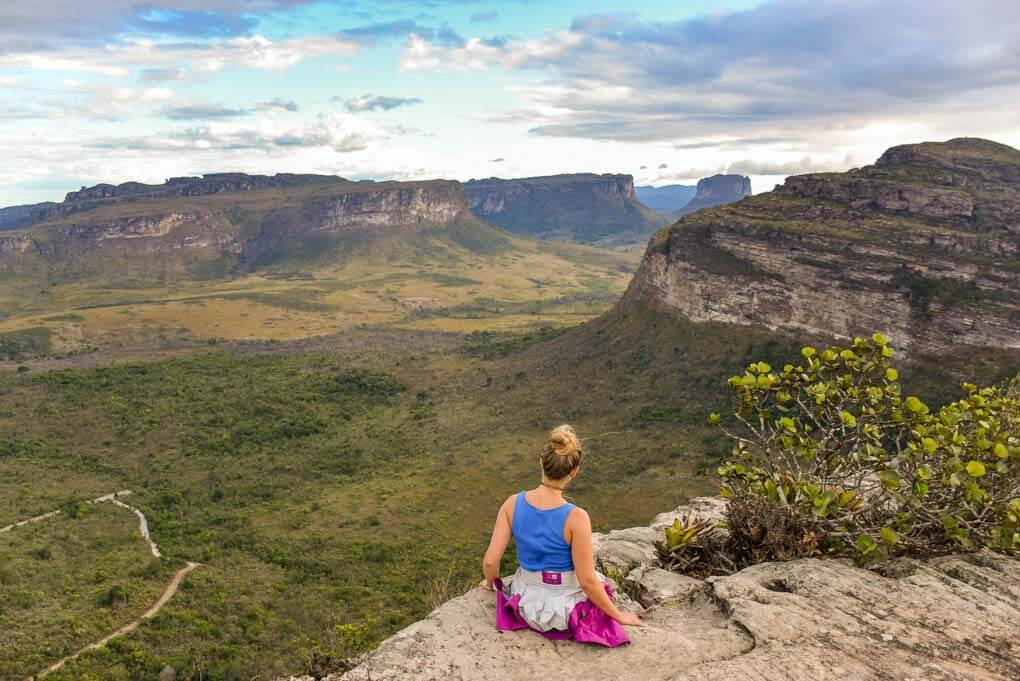 Bailey sits on a viewpoint overlooking part of Chapada Diamantina National Park in Brazil