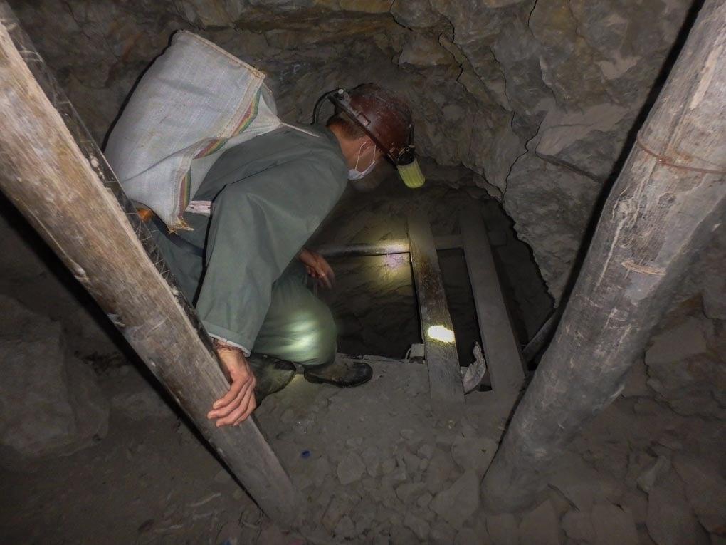 Daniel climbs down a ladder in the mines in Potosi, Bolivia