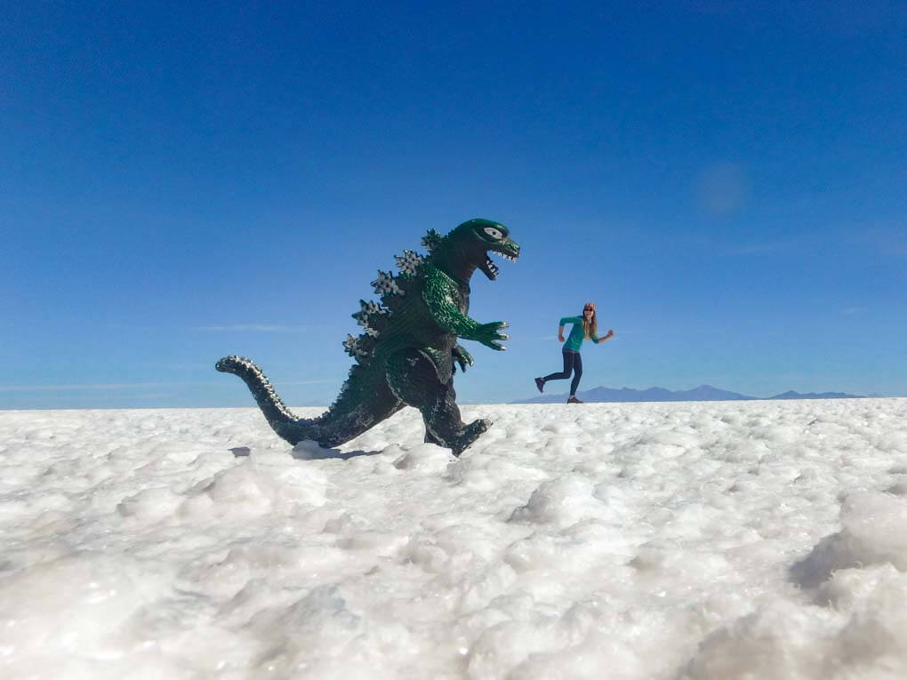 Bailey runs from a dinasaur while taking a silly photo using the salt flats