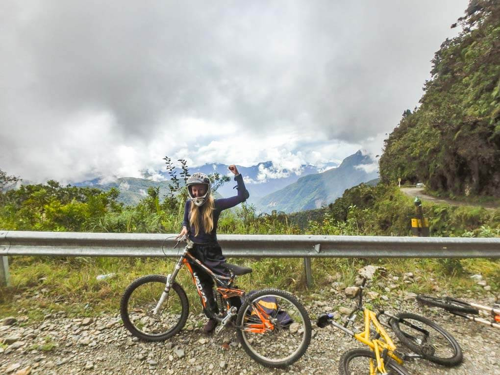 Bailey with her bike on the Death Road in Bolivia