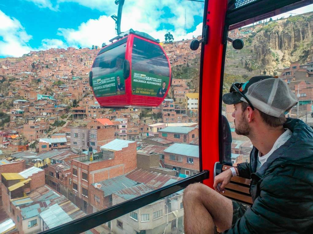 Daniel looks out the window of the gondola in La Paz, Bolivia