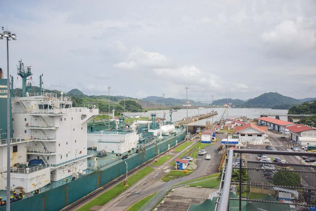 A ship leaves the narrow canals of the Panama Canal and enters the man made Gatun Lake