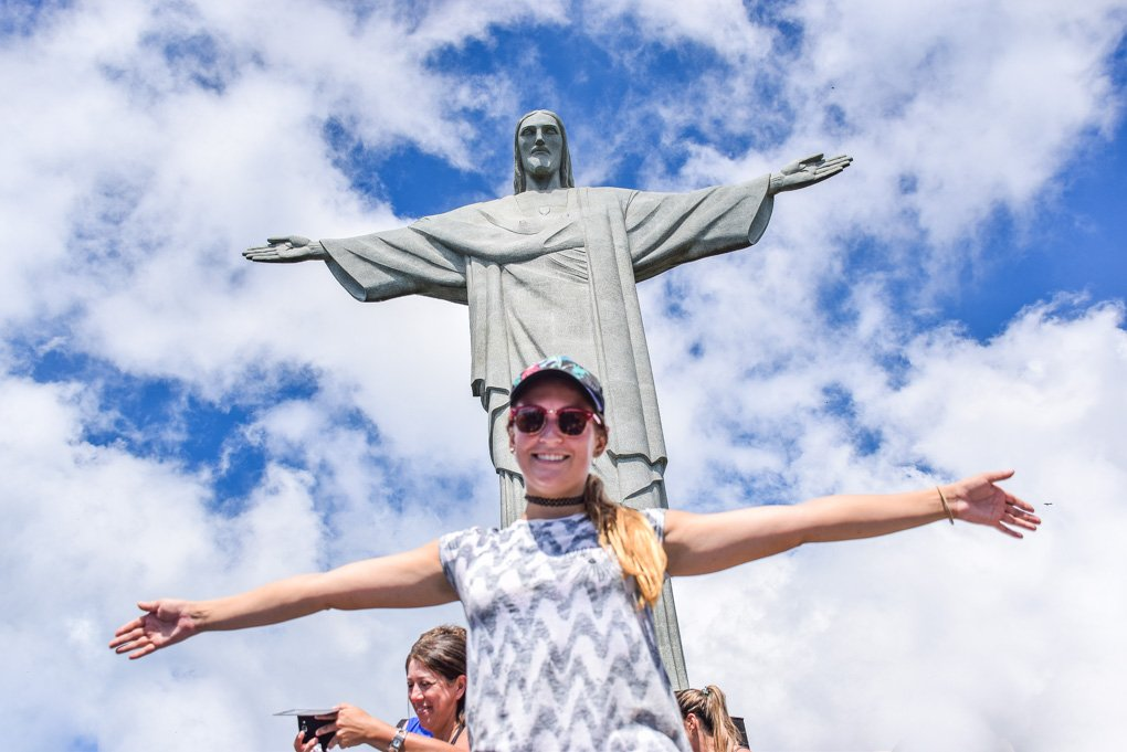 Bailey takes a photo with Christ the Redeemer in Brazil
