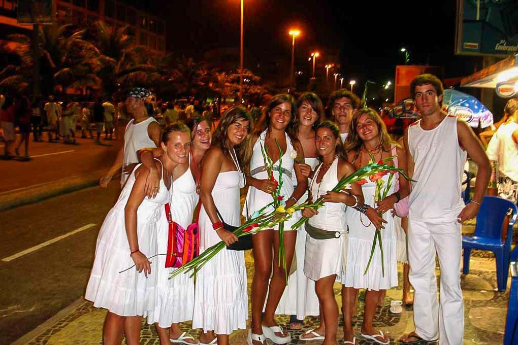 A group of poeple dressed in white get ready to celebrate the New year in Rio de Janeiro, Brazil