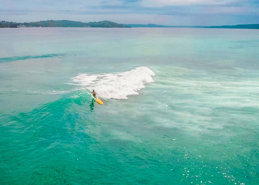 Drone shot of someone surfing in Bocas del Toro, Panama