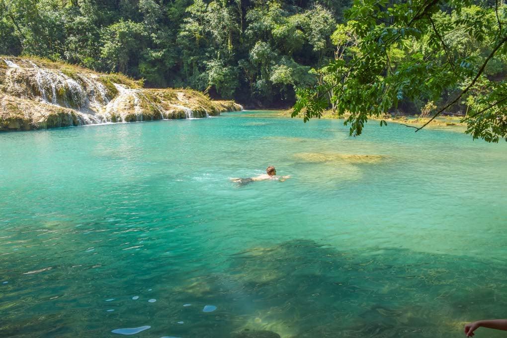 Daniel swims in a small pool at Semuc Champey, Guatamala