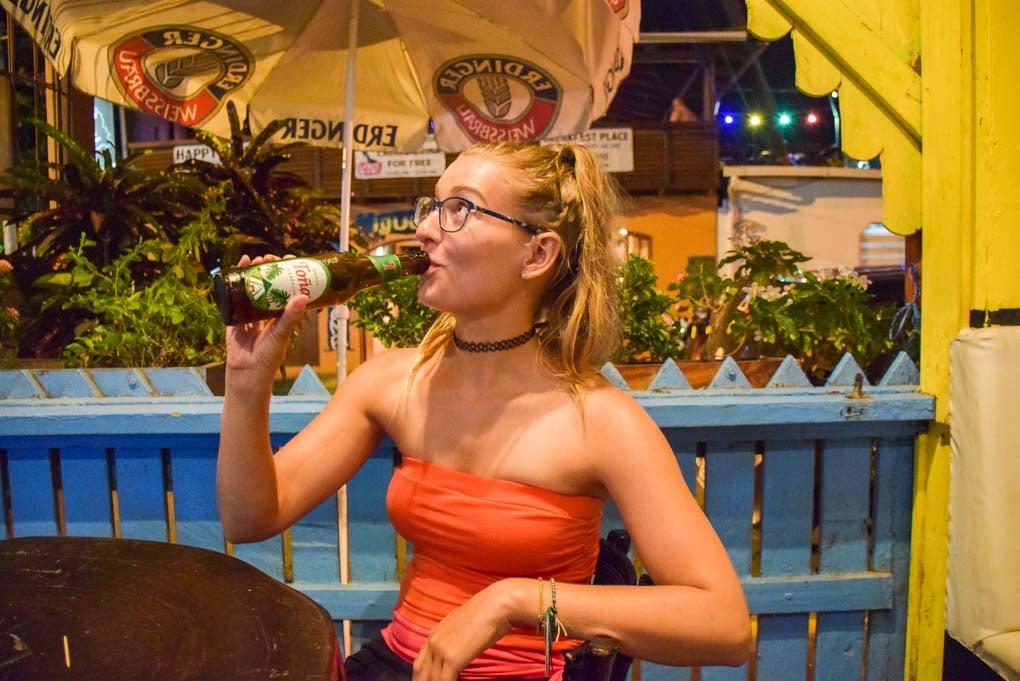 Bailey drinking a tona beer in Nicaragua