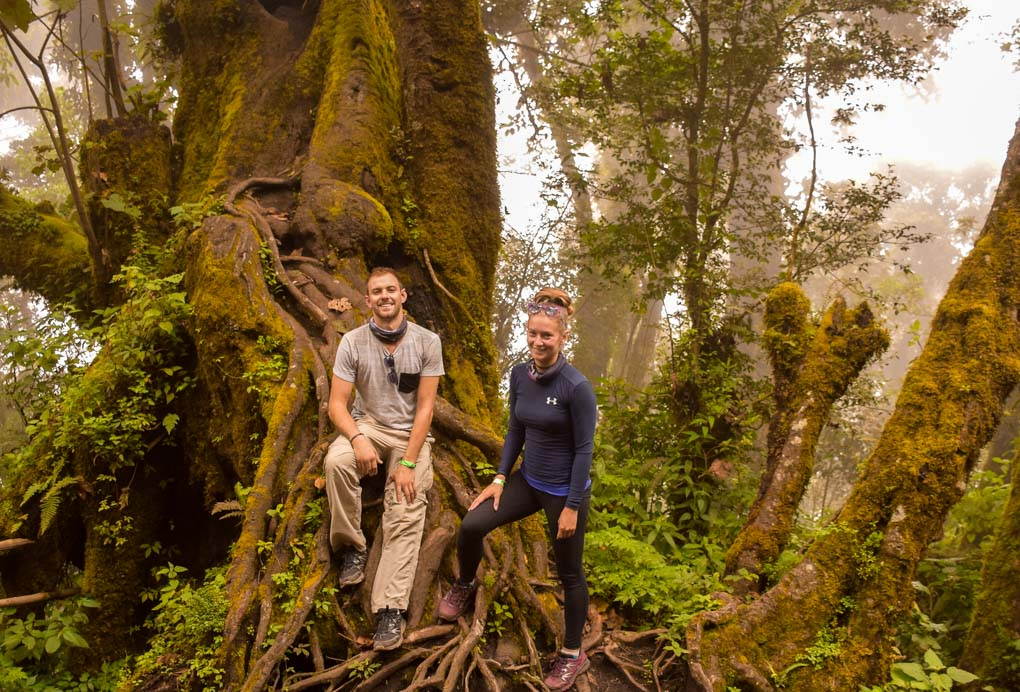 Bailey and Daniel take a photo in the forest on the Acatenango Volcano hiking trail in Guatemala