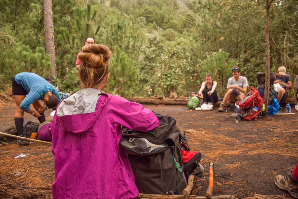 group stopped for a rest break along the Acatenango Volcano trail in Guatemala