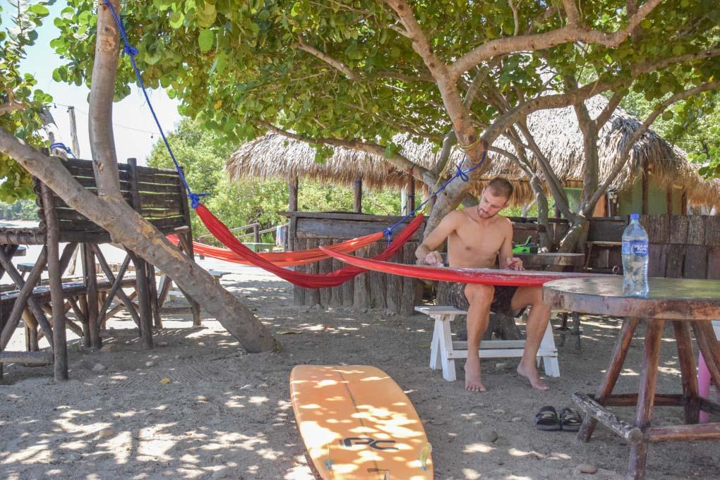 Daniel waxing his surfboard in San Juan del Sur, Nicaragua
