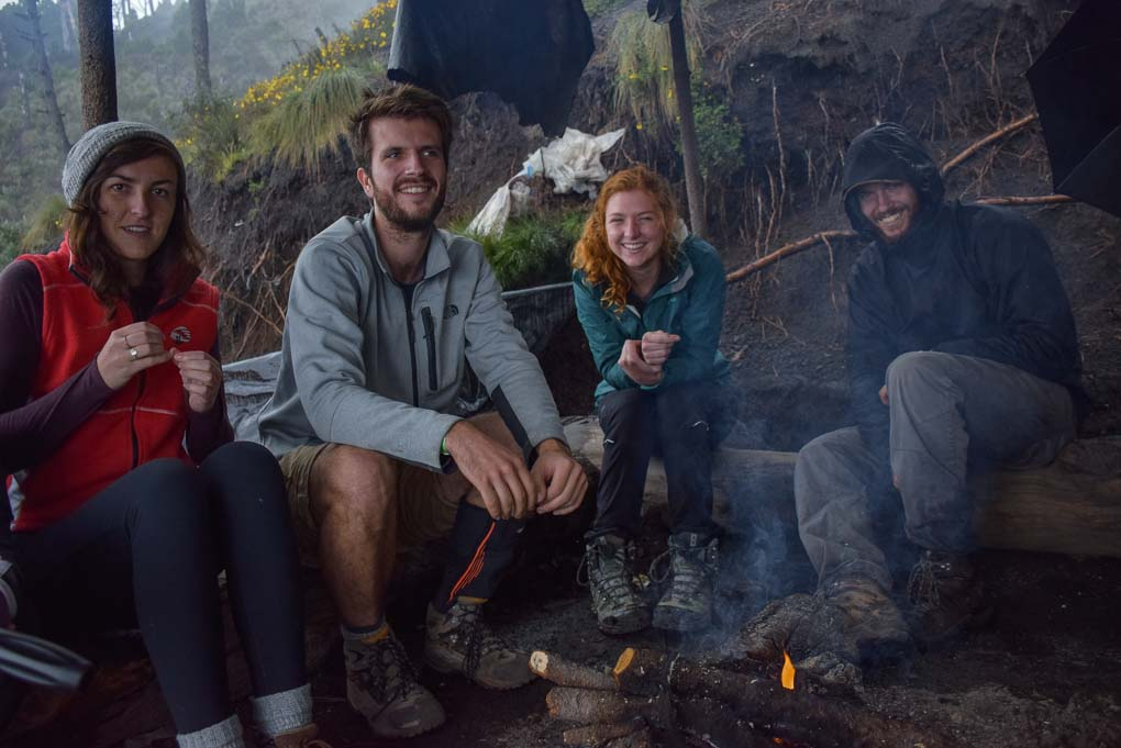 sitting around the fire at base camp on the Acatenango Volcano, Guatemala