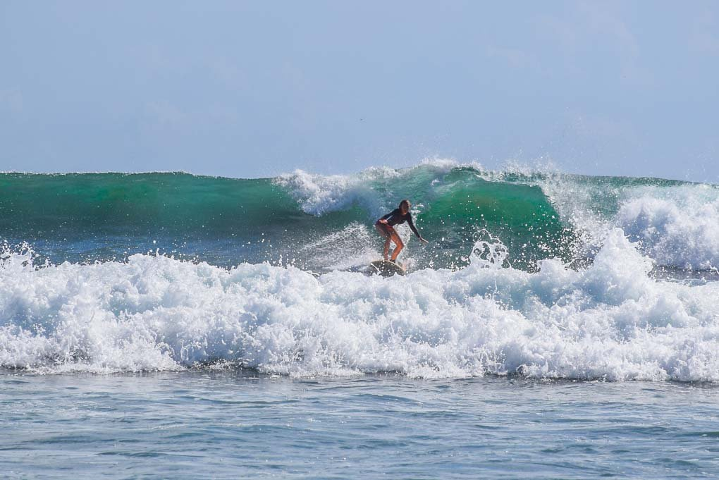A lady surfs at Popoyo Beach