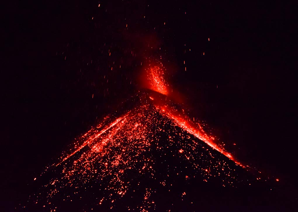 Lava erupting from Fuego Volcano in Guatemala at night