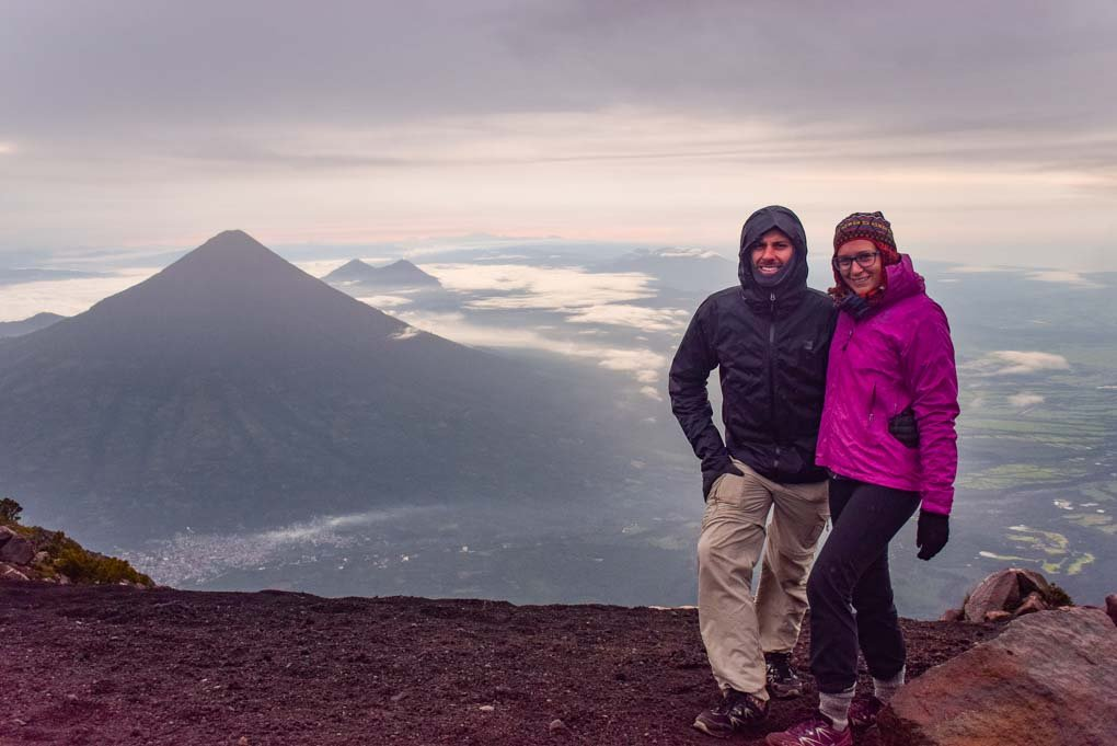standing on the summit of Acatenango Volcano with Fuego Volcano in the background