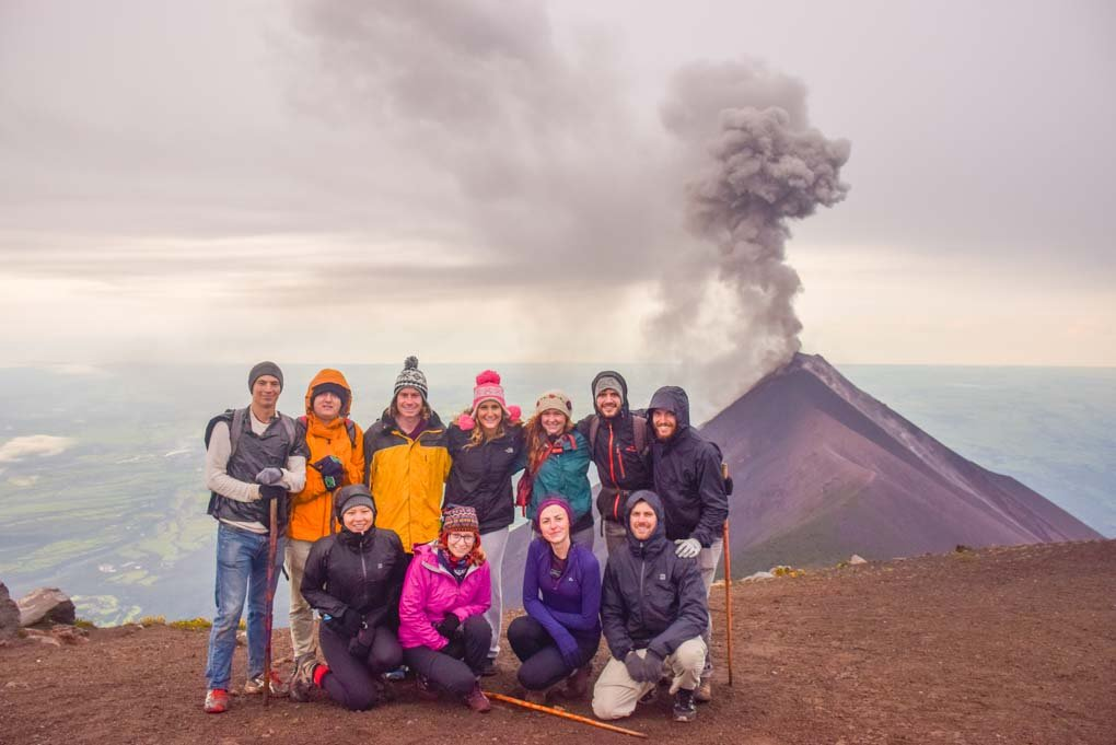 tour group photo after hiking to the top of Acatenango Volcano for sunrise