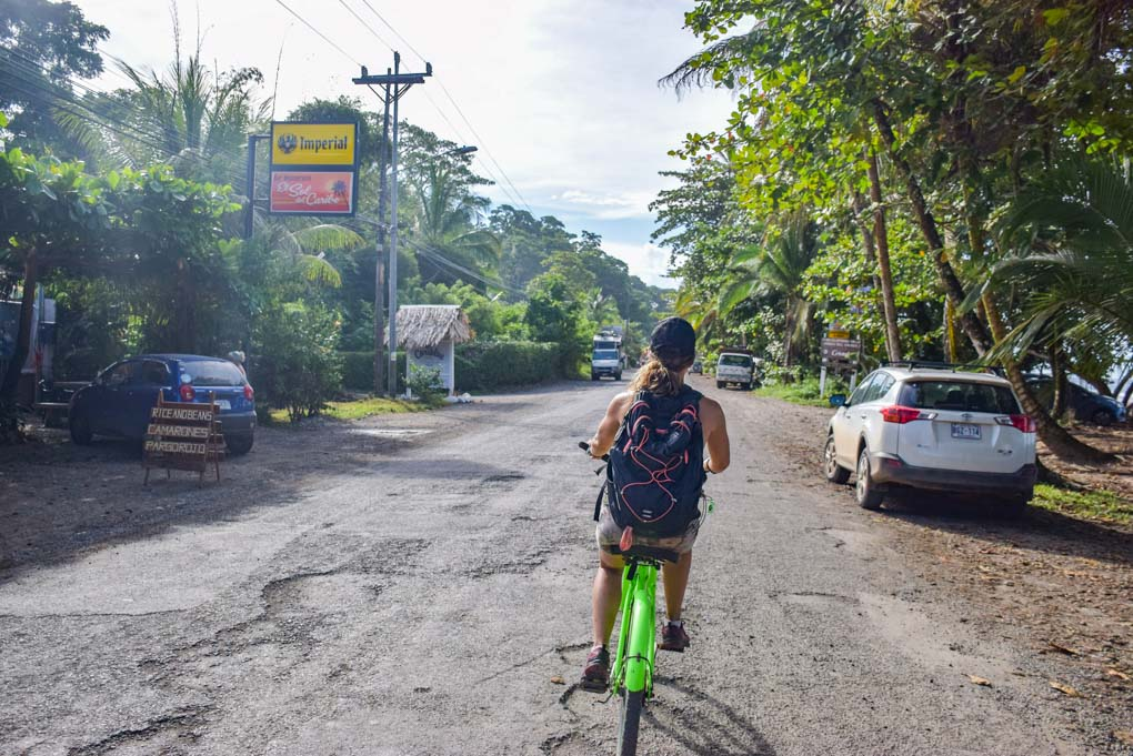 riding a bicyle in puerto viejo town in Costa Rica