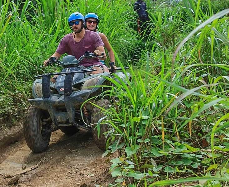 Daniel and Bailey riding an ATV