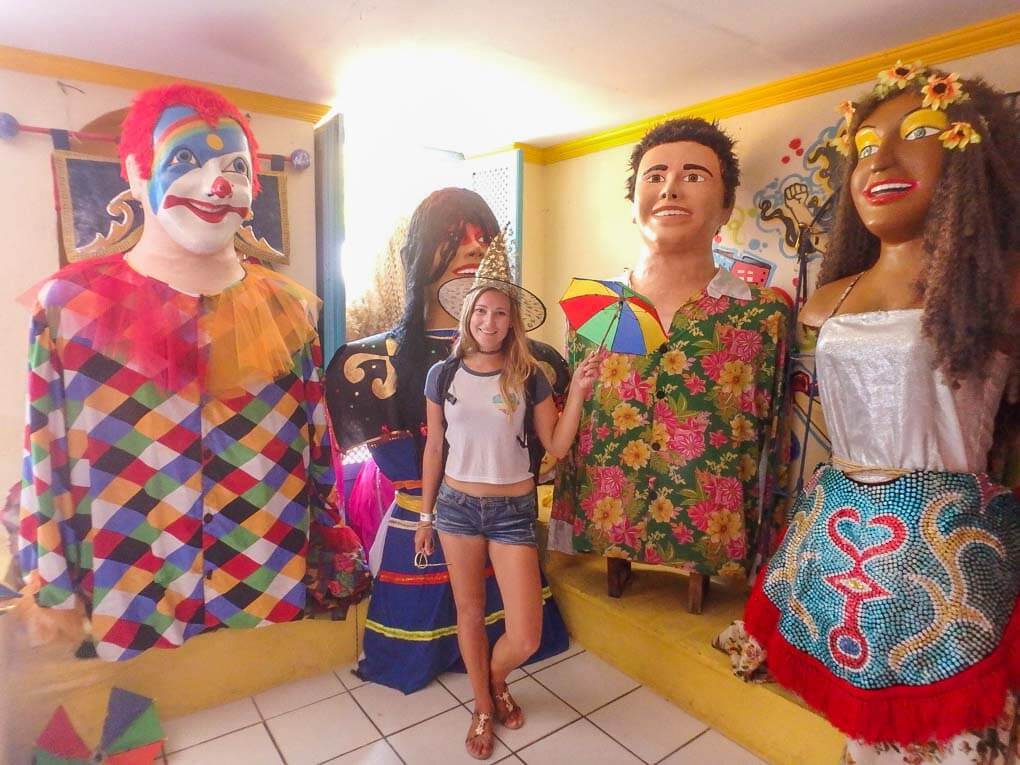 Bailey posing with carnival decorations in Olinda, Brazil