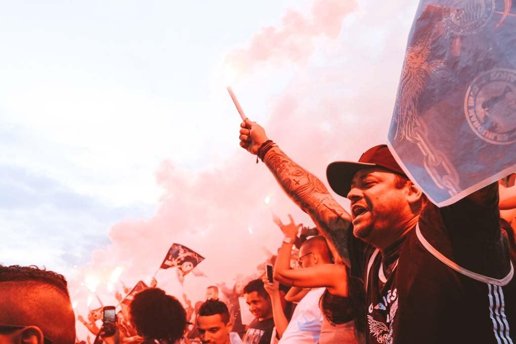 Fans cheer at a Sao Paulo soccer game