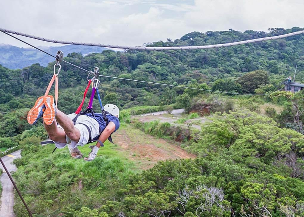 A man Ziplining in Monteverde, Costa Rica