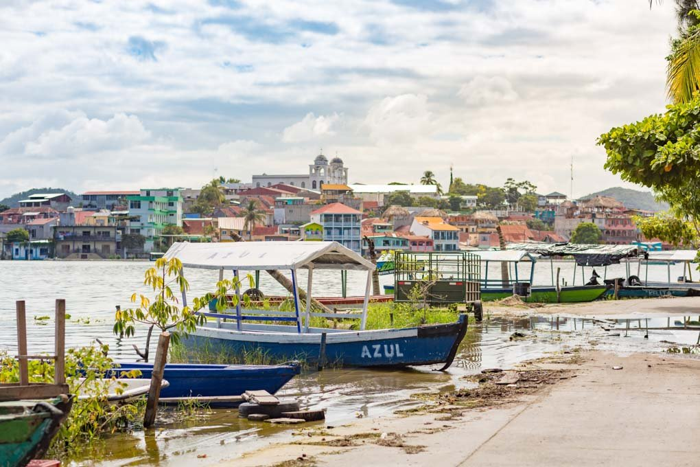 A view of a boat and the town of Flores in Guatemala