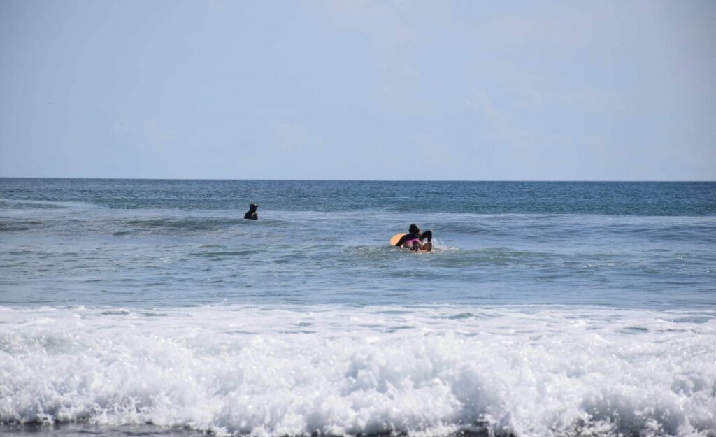 paddling on a surfboard in san juan del sur