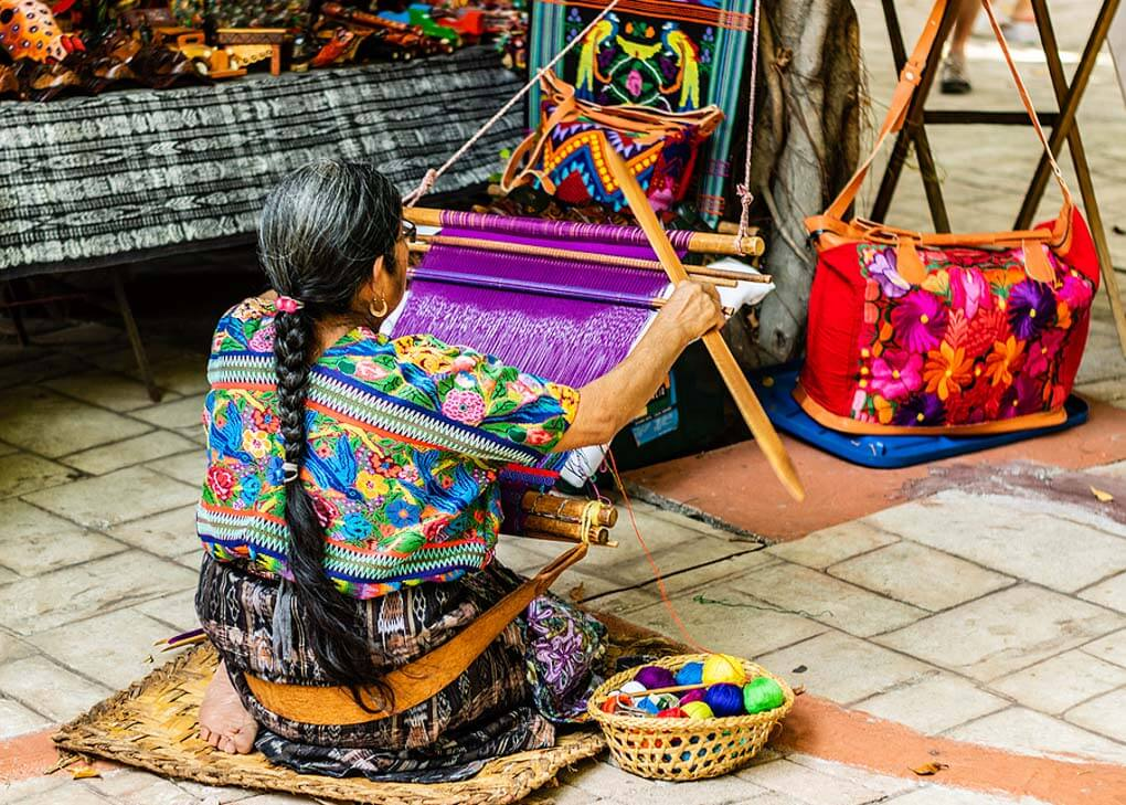 woman weaving in a traditional way in Guatemala