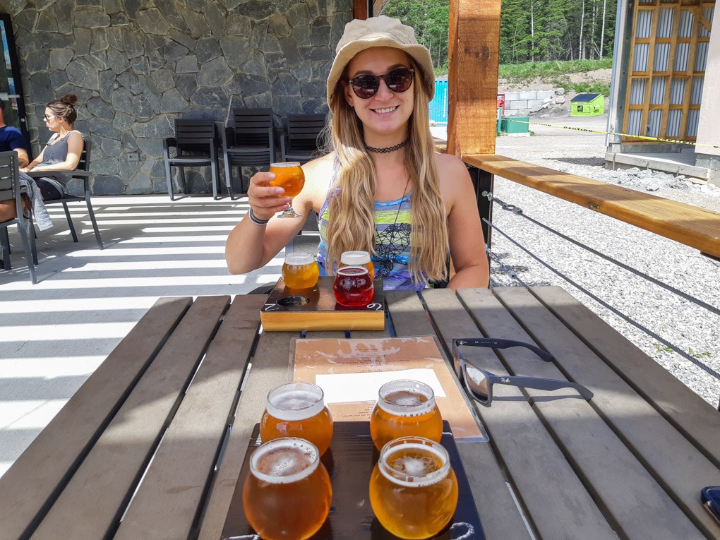 A lady drinks a bear at Folding Mountain Brewery and Taproom