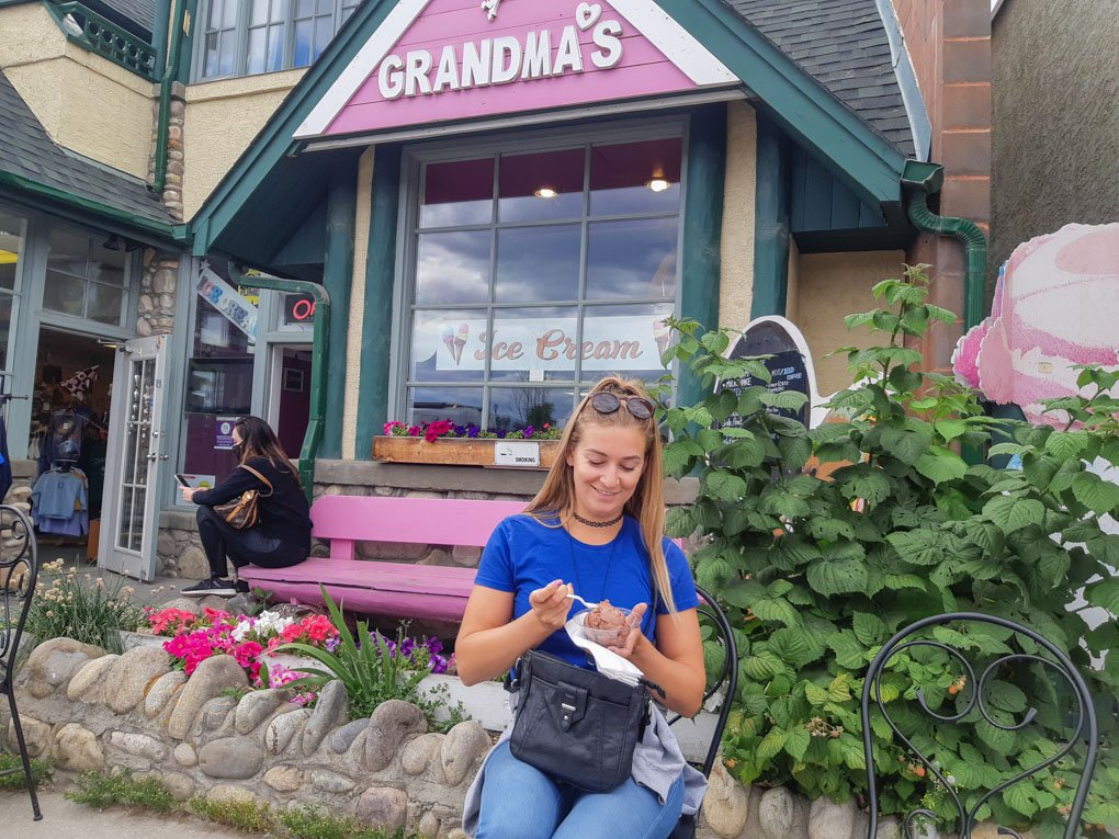 A lady east her ice cream outside of Grandma's Ice cream in jasper
