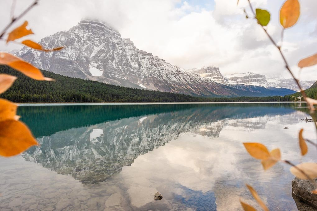 Stunning reflections at Waterfowl Lake Viewpoint on the Icefields Parkway scenic drive