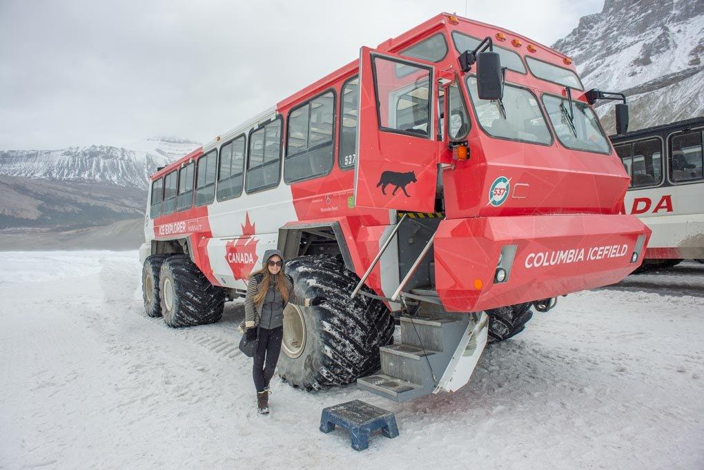 Bailey stands next to the 4wd bus on the Athabasca Glacier Icewalk tour