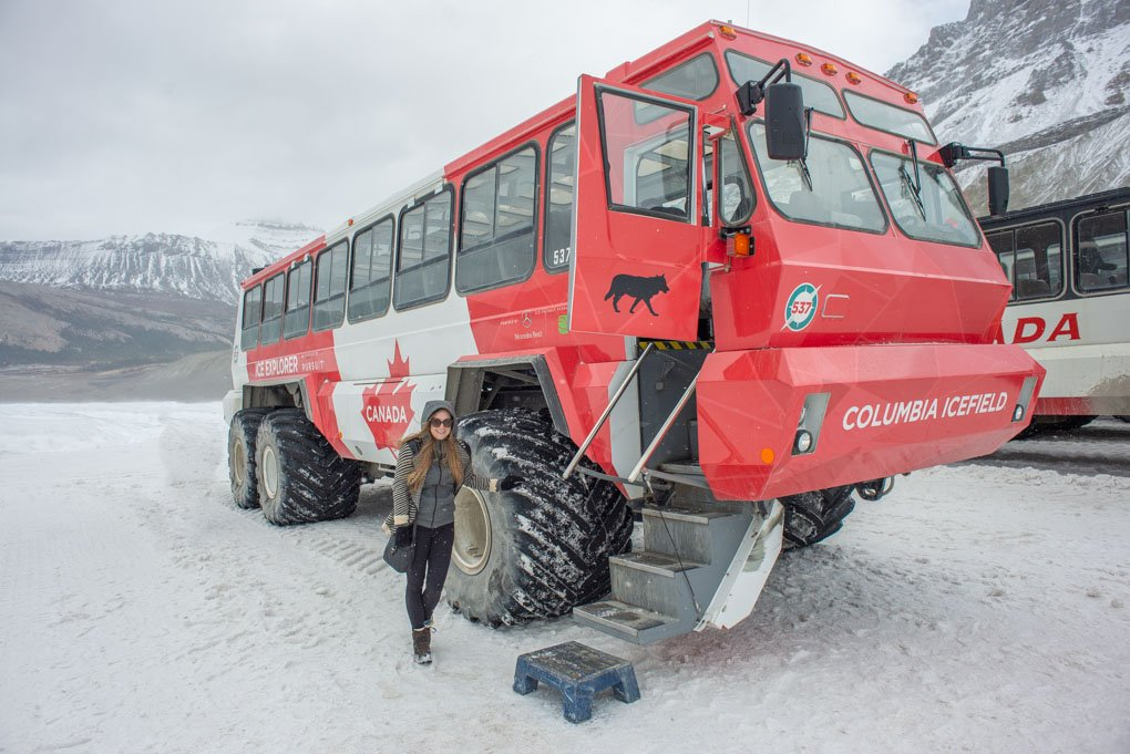 Bailey takes a photo with the glacier car on the Athabasca Glacier