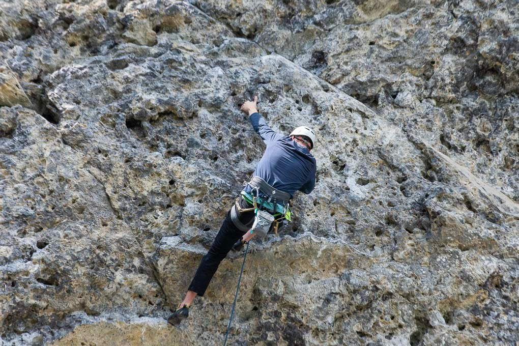 A man rockclimbs at Grassi Lakes in A man rock climbs at Grassi Lakes in Canmore, ABCanmore, AB