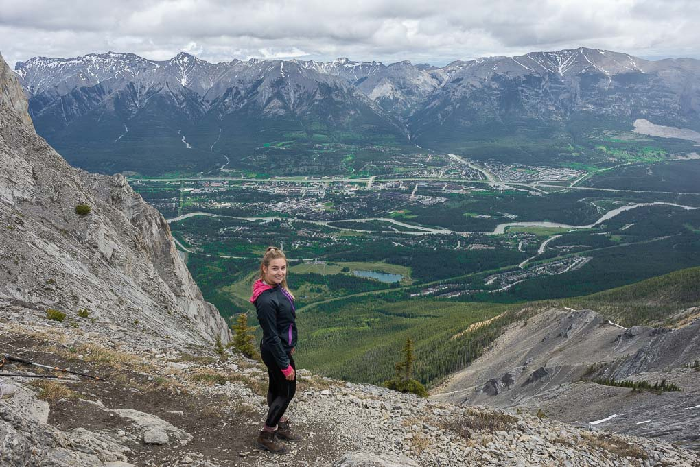 Bailey stands at the top of Ha Ling Peak in Canmore, AB