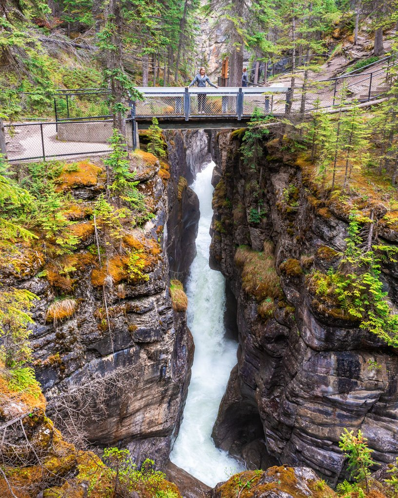 Bailey standing on the second bridge at Maligne canyon in Jasper, Canada