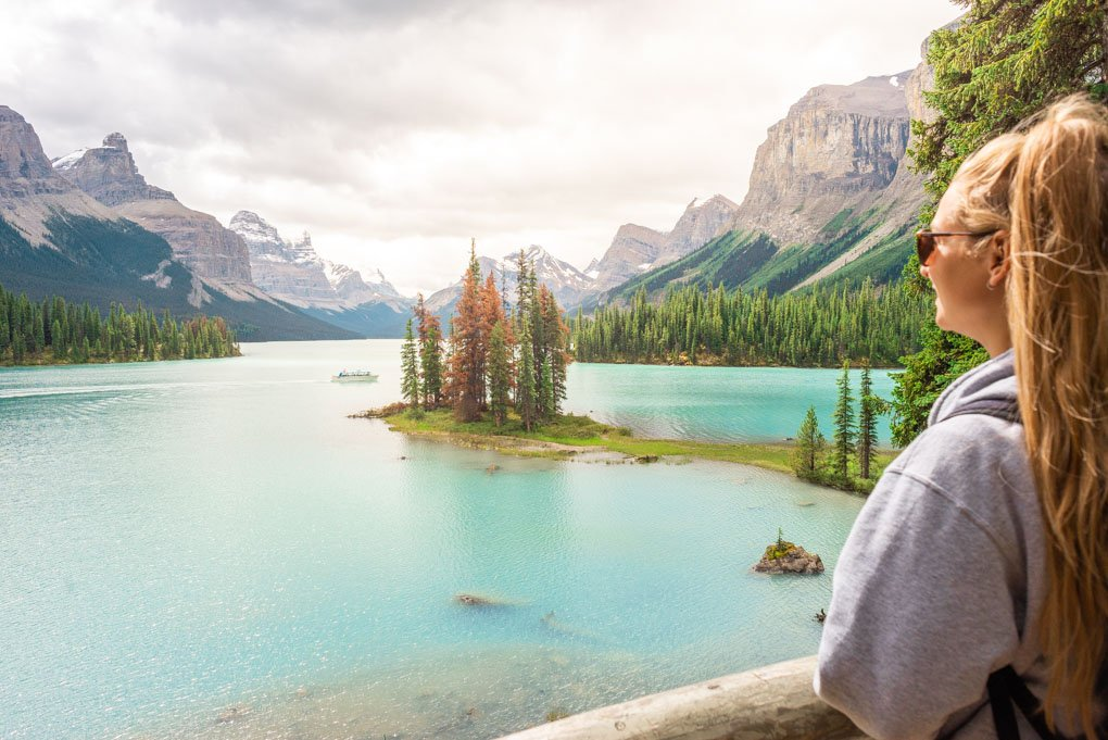 A lady looks over at Spirit island from the viewpoint visited on the maligne Lake cruise