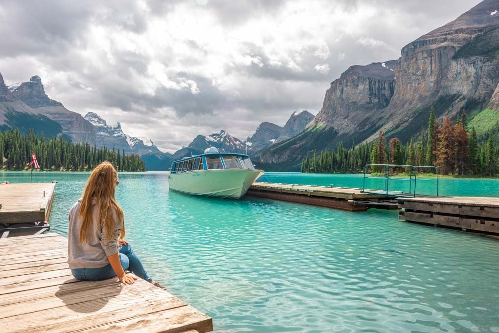 Bailey sits on a dock at Spirit Island after hopping off our Maligne Lake Cruise in Jasper National Park