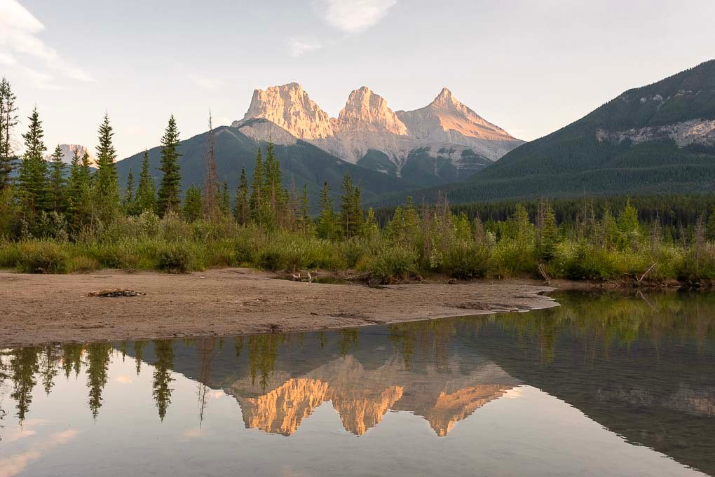 A reflection shop of the Three Sisters Mountain Range in Canmore