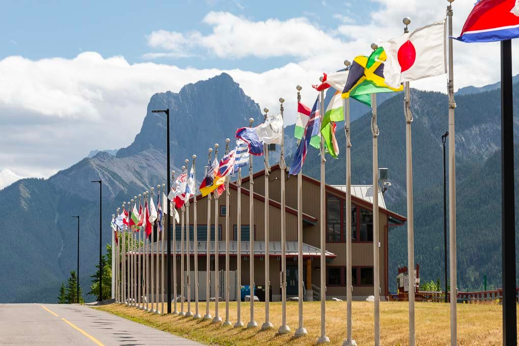 The country flags from the olimpic games held at the Nordic Center in Canmore