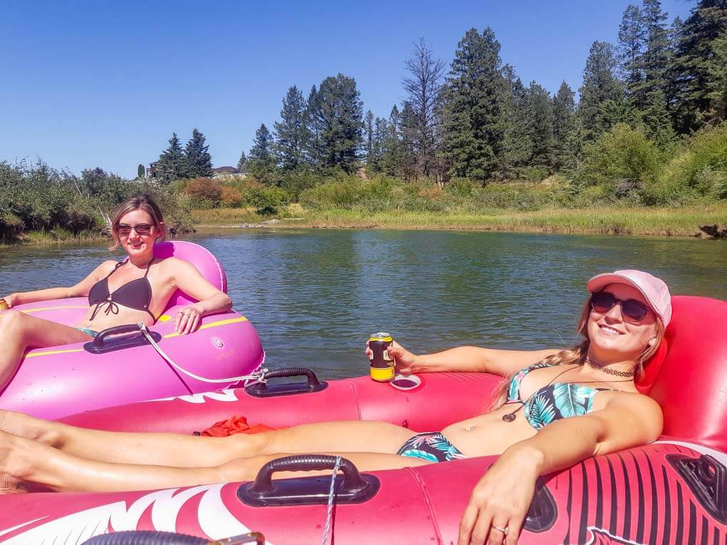 Two girls relax in their floaties while on the Columbia River float