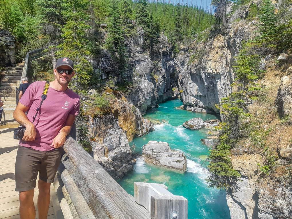 A man stands on a bridge at Marble Canyon in Kootenay National Park
