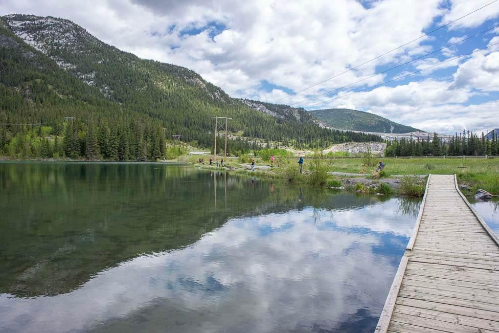 A reflection shot at Grotto Lake while people fish
