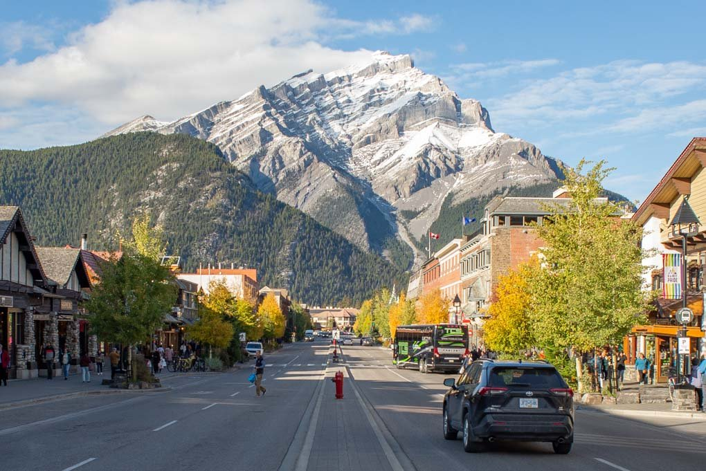 Photo of Banff Ave in Banff Town howing how beautiful the street is wioth the surounding mountains