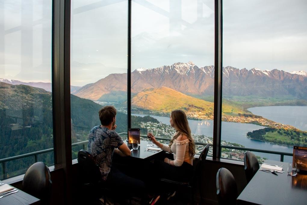 A couple enjoy a honeymoon dinner at the Skyline restaurant in Queenstown New Zealand